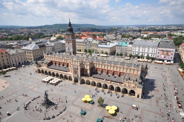 Krakow's lively Market Square is filled with people day or night.